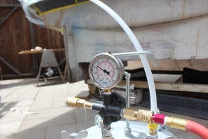 Vacuum gauge attached to vacuum bucket.
