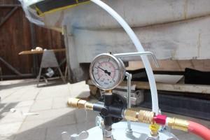 Vacuum gauge attached to vacuum bucket.